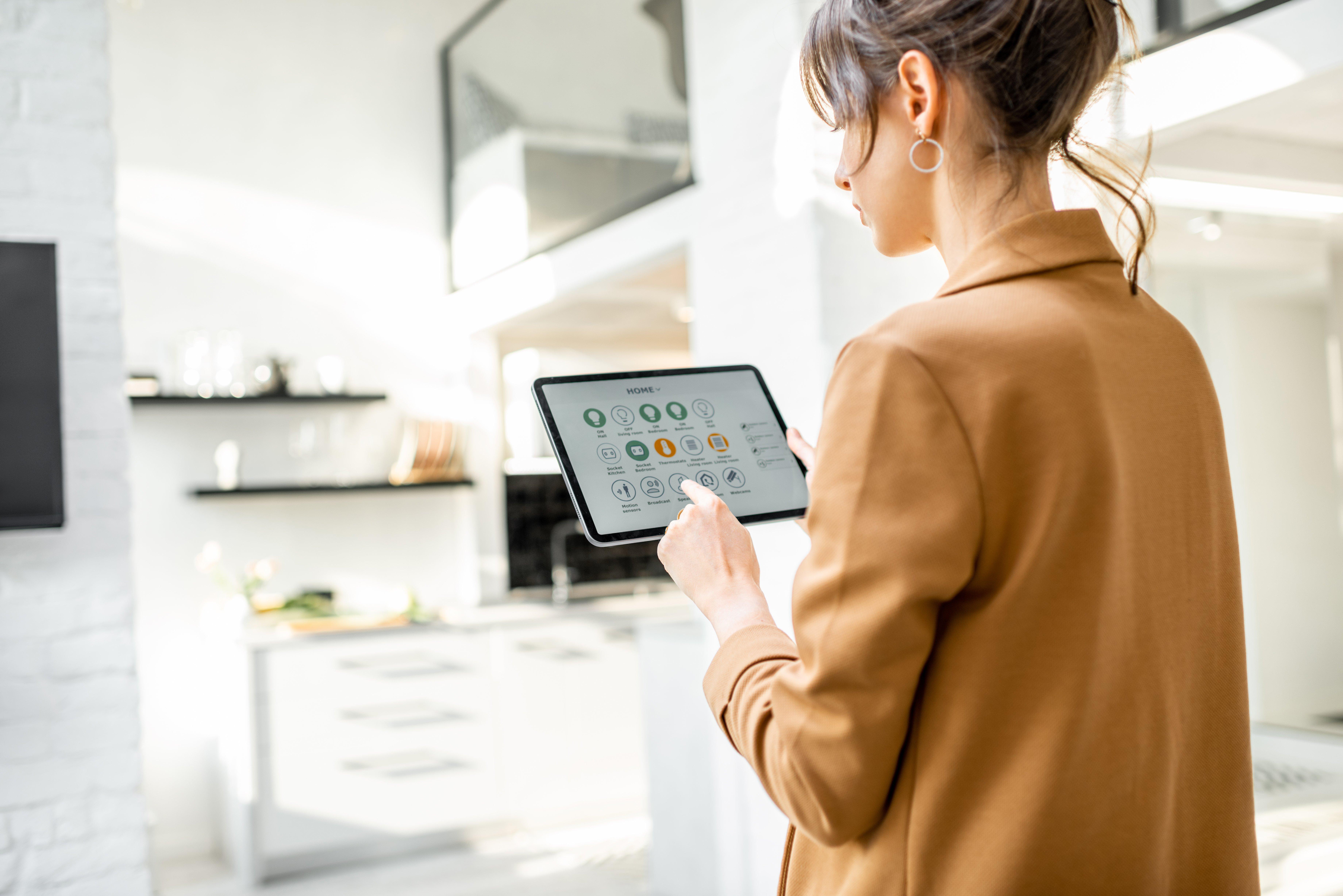 Woman using smart doorbell interface